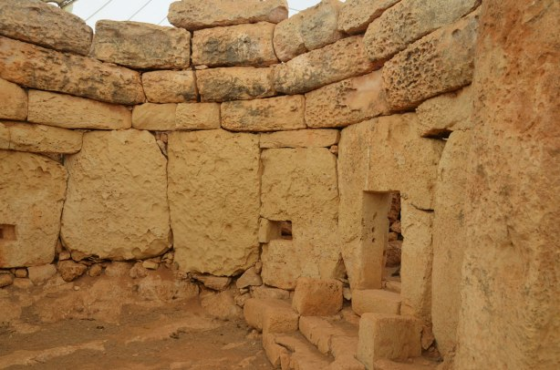 curved walls of a megalithic prehhistoric limestone site in Malta