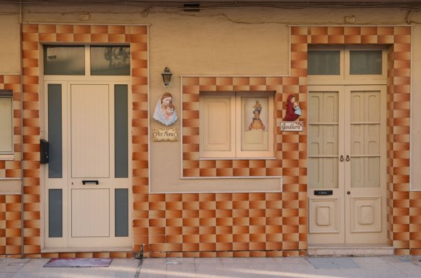 Two adjacent doorways with very busy tiles in gradations of browns and rusts.