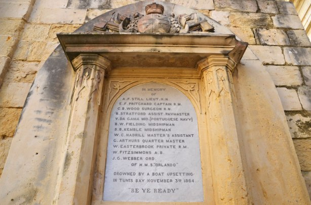 Memorial to sailers who drowned in the Mediterranean Sea in 1864, names carved on a plaque in stone.
