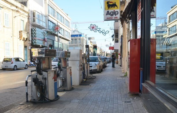 gas pumps on a sidewalk filling station, Agip, on a street in the town of Mosta