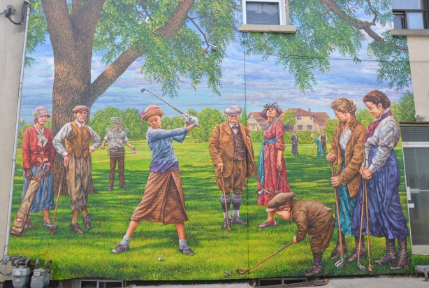 mural of a group golfing in clothes typical of the 1940s