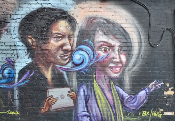 Graffiti picture of two people, a man and a woman,