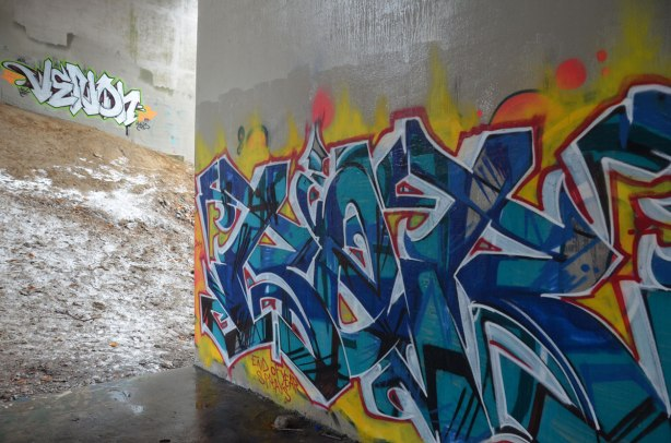 Graffiti tags under a bridge