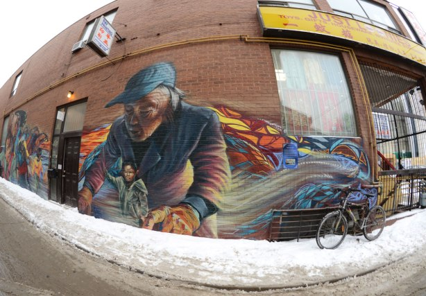 Right end of the Chinatown mural, the end that is closest to Dundas St.   The shop that is next to the alley in which the mural is painted can be seen in the photo.