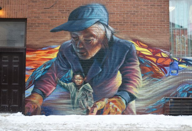 Part of the Chinatown mural - an older woman is with a small child