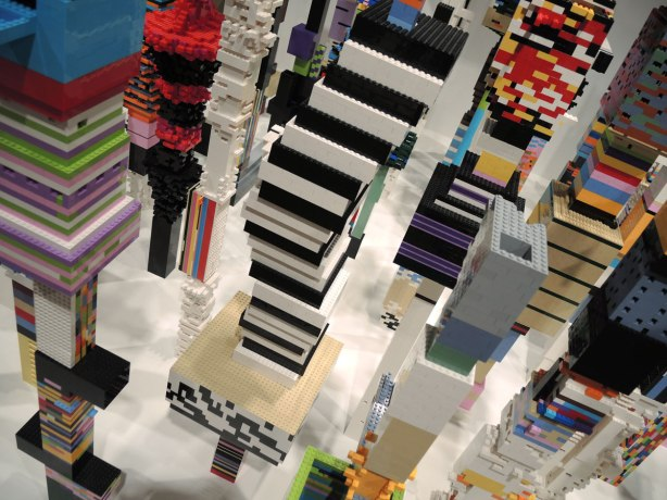 Close up of some of the brightly coloured lego towers in the art exhibit