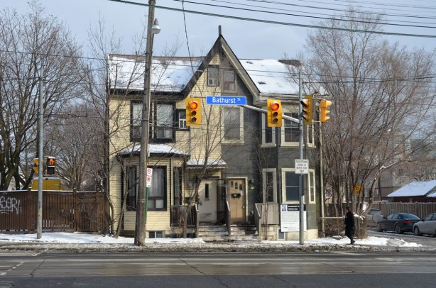 an older two storey brick semidetached house at the corner of Bathurst and Robinson.  No other houses are next to it.