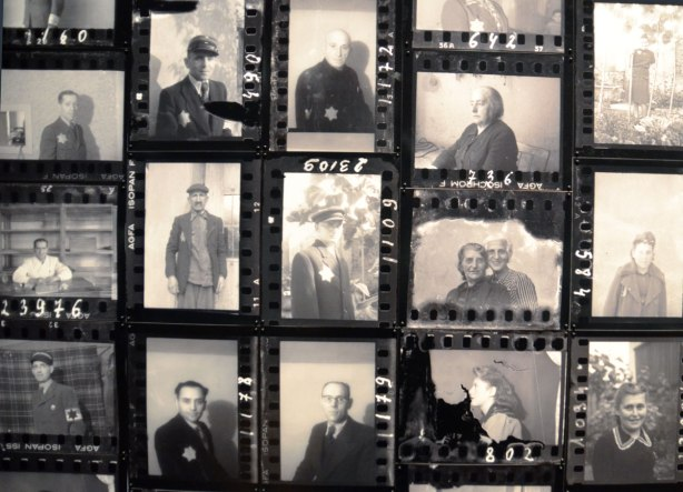 Close up of photo display showing black and white photos of people in portrait like photos.