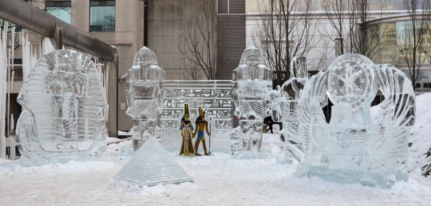 Four ice sculptures with Ancient Egyptian themes - King Tut, and a pyramid amongst them.   Also a wall of hieroglypics with two guards beside it.