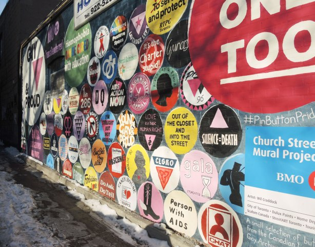 Close up of part of a mural that is circular buttons from the gay and lesbian community with slogans and sayings on them.
