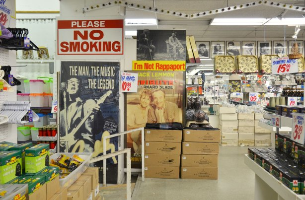 Interior photograph of Honest Eds store with its eclectic mix of merchandise.  Big No Smoking sign on the wall, some old movie posters on the wall too.