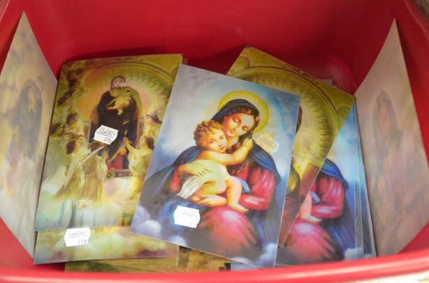postcards with holographic images of Mary and Jesus.