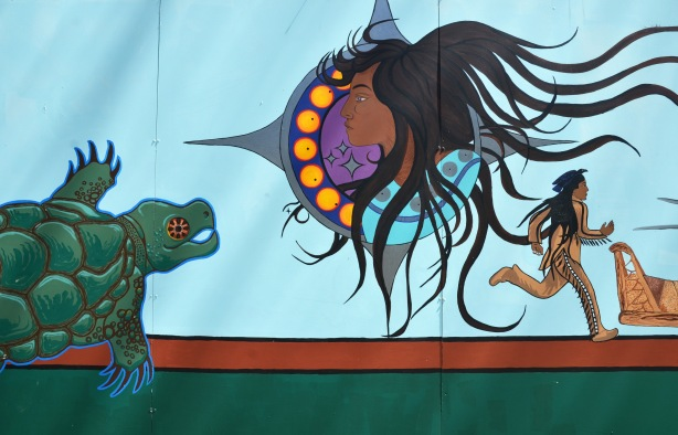 part of an Anishnawbe First Nations story/legend themed mural painted on wood construction hoardings in Allan Gardens