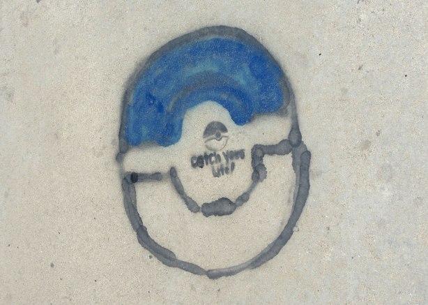 black paint with stencil graffiti on a sidewalk