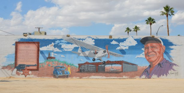 mural depicting the story of Jack Cones, a policeman who flew airplanes.