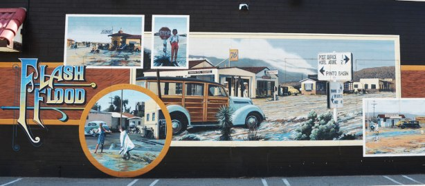 mural showing scenes of a flash flood that passed through the town of Twentynine Palms.  Left side of the mural.