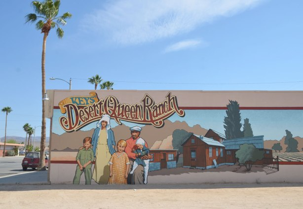 A mural titled 'Keys' desert queen ranch' with a painting of the ranch building as well as the Keys family.
