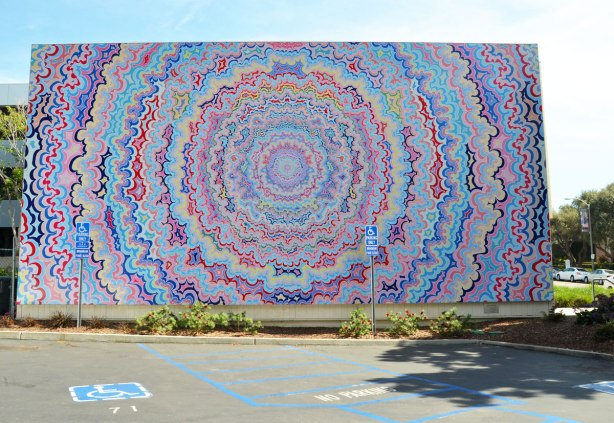a large mural of concentric circles of wavy lines, almost psychadelic  in nature.