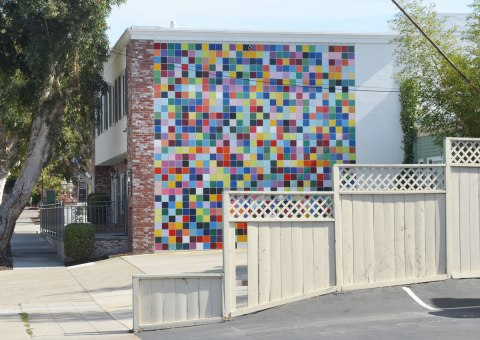 Wall of a building that has been covered with multicoloured square tiles