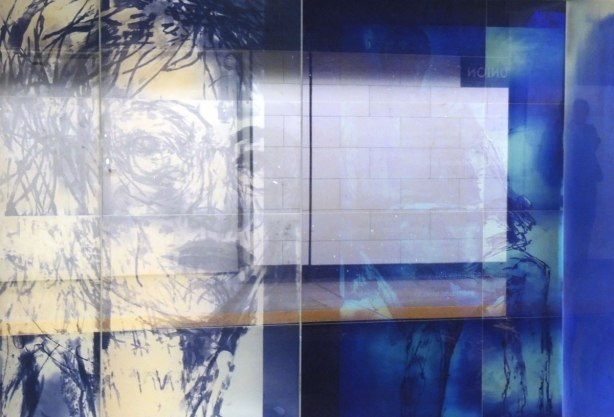 new art, pictures of people on the subway, on glass panels installed at Union Station platform - two blue glass panels, one with a woman's face