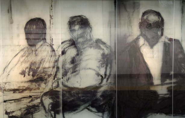 new art, pictures of people on the subway, on glass panels installed at Union Station platform - 3 men sitting on the subway, all facing the viewer