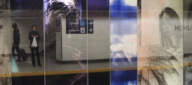 new art, pictures of people on the subway, on glass panels installed at Union Station platform - several panels with pictures of people but it is highly reflective so you can see the people waiting on the platform as well