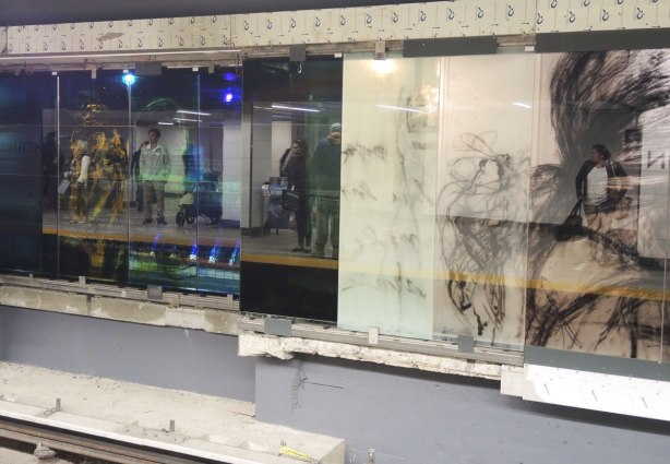 new art, pictures of people on the subway, on glass panels installed at Union Station platform  several panels with pictures of people but it is highly reflective so you can see the people waiting on the platform as well