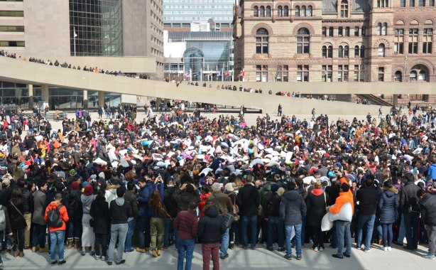 crowds of people at Nathan Phillips square on a spring Saturday afternoon