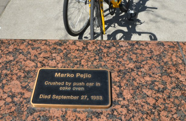 A black and brass plaque commemoration Marko Pejic who died in 1983