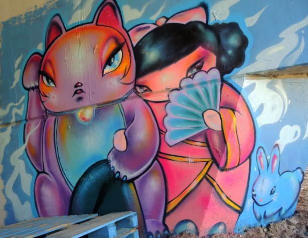 graffiti painting - Lovecat and a Japanese girl in pink kimono hiding her face behind a blue fan.  A cute little blue bunny is in the bottom right.