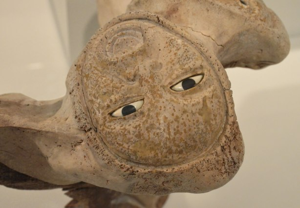 part of a sculpture by Manasie Akpaliapik made of bone, ivory and stone, a person's face