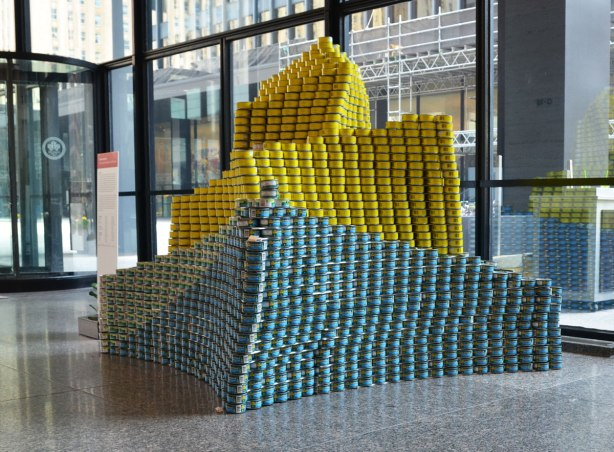 sculptures on display that were entered in a contest in support of the Daily Food Bank, sculptures made of canned food in a theme pertaining to hunger awareness - a calla lily in yellow and blue cans