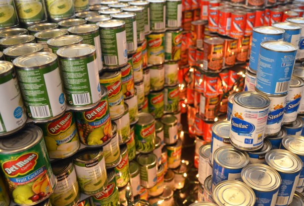 sculptures on display that were entered in a contest in support of the Daily Food Bank, sculptures made of canned food in a theme pertaining to hunger awareness - close up of a representation of the brain with a string of little lights representing the brain at work