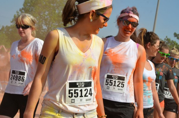 Young women wearing sunglasses, color me rad run