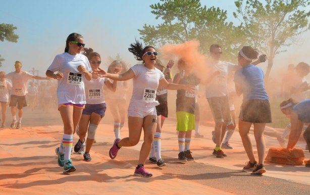 running through clouds of orange powder, color me rad run