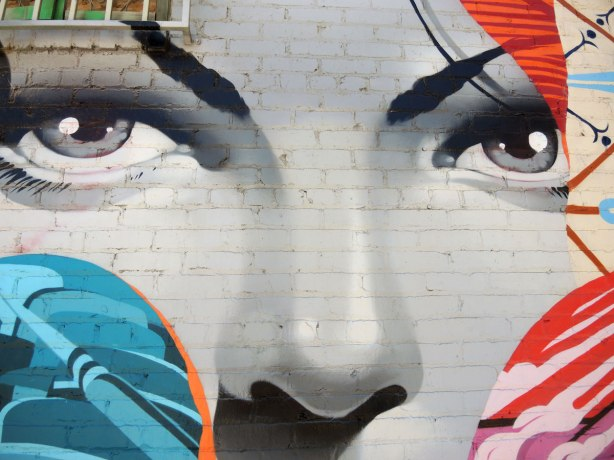 Close up of a woman's face, part of a mural on East 4th Street in Los Angeles.   Large than life size.