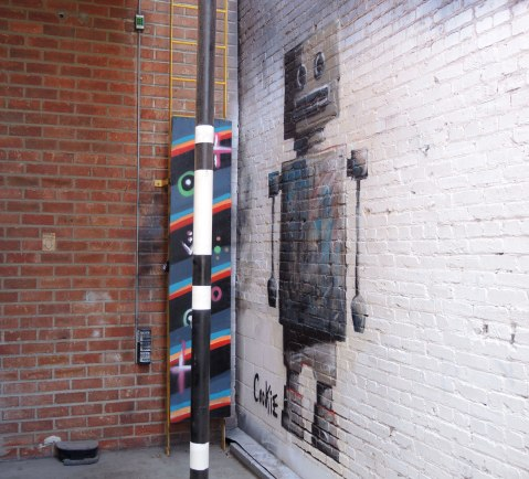 tall graffiti robot with a square head.  Signed 'Cookie'.  He's in a corner and not that well seen unfortunately