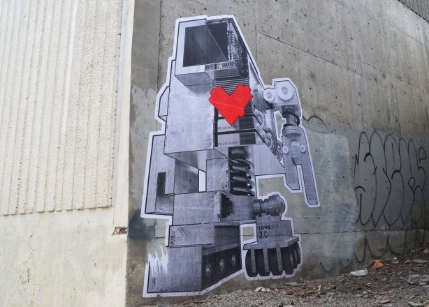 very large new lovebot robot on a grey wall