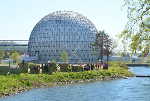 Ontario Place cinesphere, the dome, with an obstacle course being run in front of it