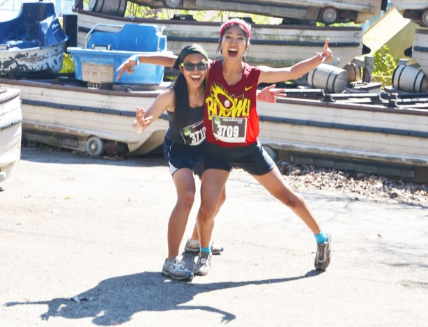 Two young women, mud hero participants, pose for the camera