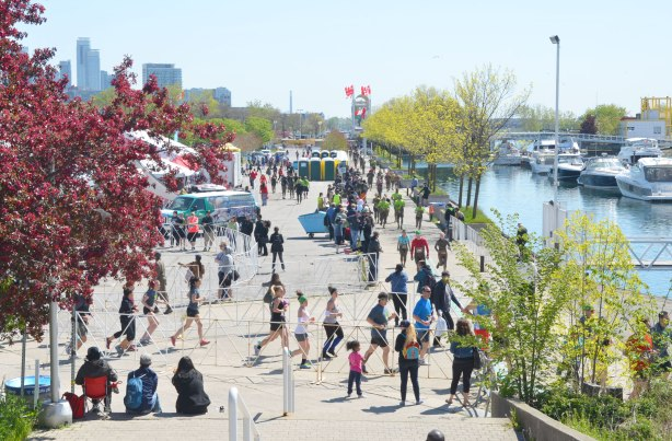 At Ontario Place, looking towards the meeting area for the Mud Hero race - where the race starts and finishes.  Some competitors are just heading out and some muddy runners are just coming back in.