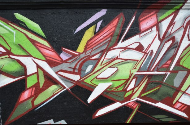 street art painting in geometrics, especially trianges and angled lines.