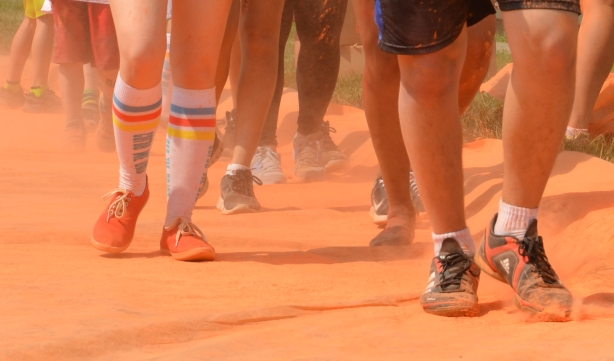 shoes covered with orange powder, and socks and legs