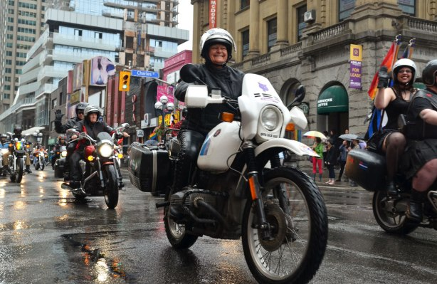 motorcycles in the rain, dyke march parade, down Yonge St. in Toronto