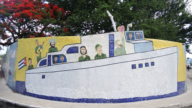 tile mural representing 'granma' which refers to the coming of the two Castros and Che Guverra in a boat to Cuba.  Large white boat with the men on board