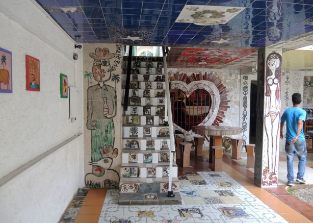 floor, walls and stairs covered with tile mosaics