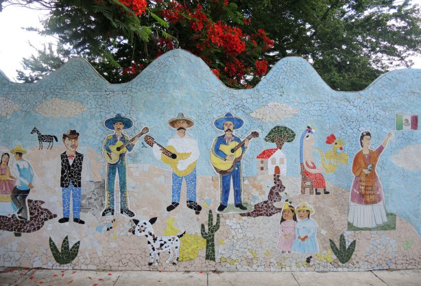 tile mosaic of a line of Latin AMerican people, three are wearing hats and playing guitars