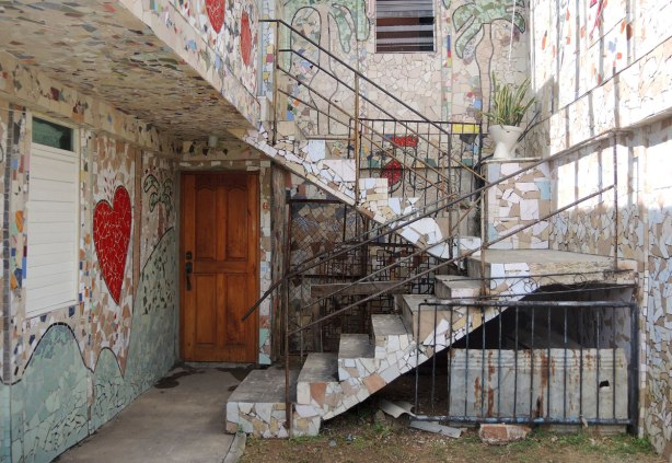 exterior staircase covered with small tiles, including a mosaic of a large red heart