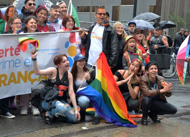 part of a group photo taken after the pride parade.  Group is Conseil scolaire viamonde, le success s'exprime en francais, an association of French schools in Ontario