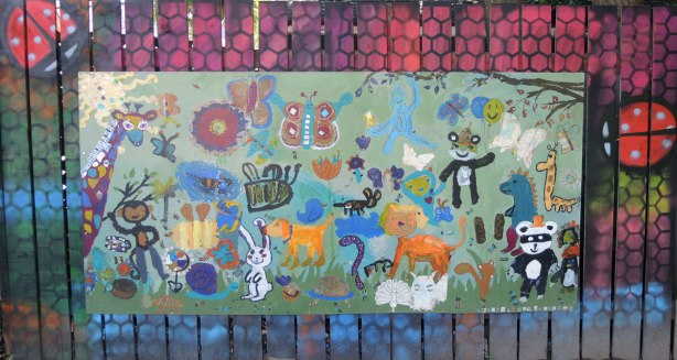 Mural done by a youth group of many different kinds of animals
